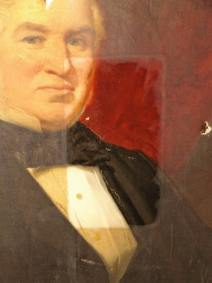 Detail of cleaning to 19th Century portrait.